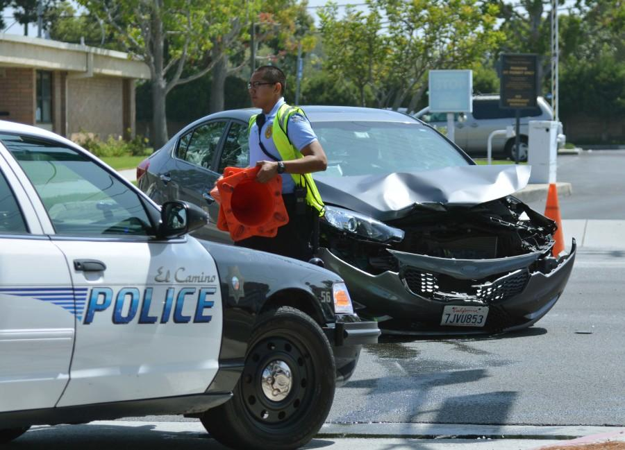 A two-car collision closed the southbound lanes of Crenshaw Boulevard in front of the Administration Building around 11 a.m. snarling fall semester traffic. El Camino police officers quickly responded and set up traffic control around the scene. Photo credit: John Fordiani