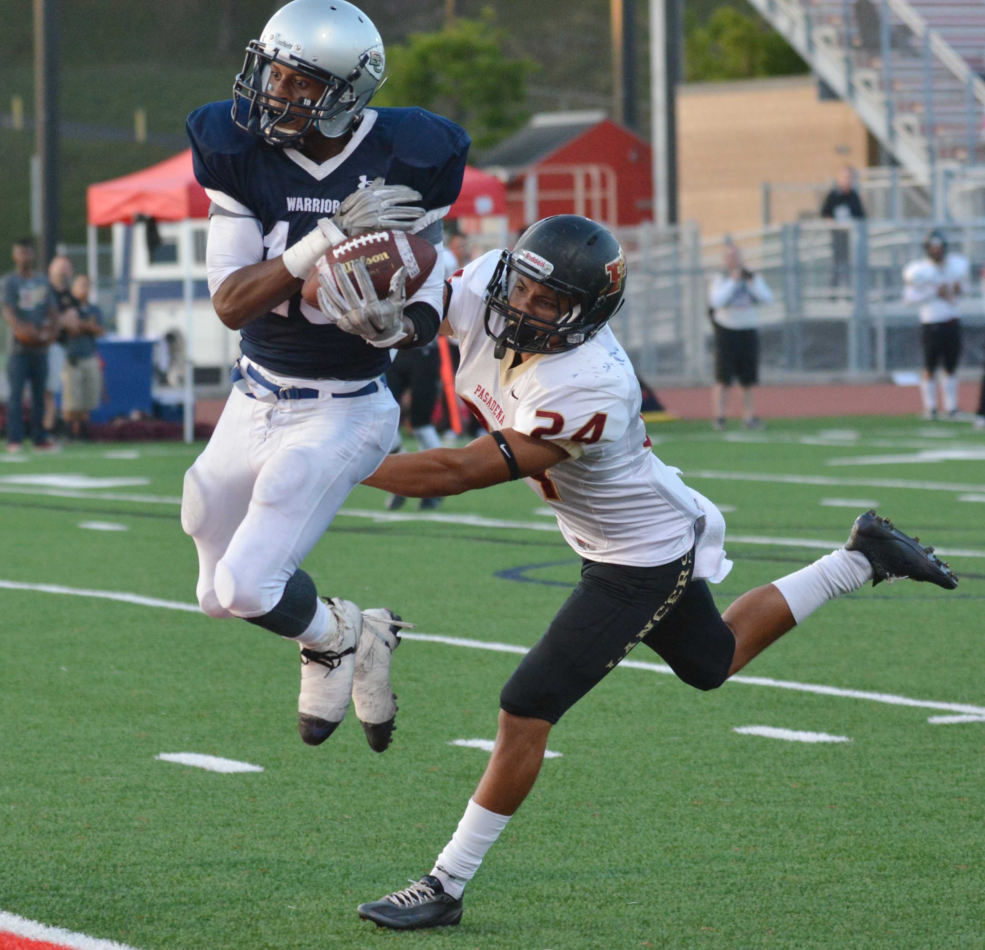 Defense holds football up in season opener