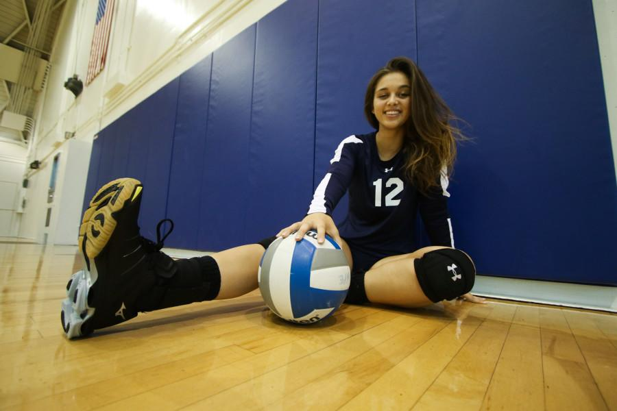 Freshman+setter+Nina+Wyer+poses+with+a+ball+in+the+South+Gym.+Wyer+has+been+a+big+asset+for+the+women%27s+volleyball+team+and+leads+all+setters+in+assists+with+257+assists+this+season+and+leads+in+assists+per+set+%286.27%29.+Photo+credit%3A+Jorge+Villa