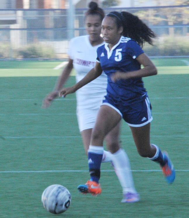 Freshman defender Princess Butler sprints away from a defender on Friday. The women's soccer team defeated El Camino-Compton Center 4-0 on Friday. Photo credit: Shontel Leake