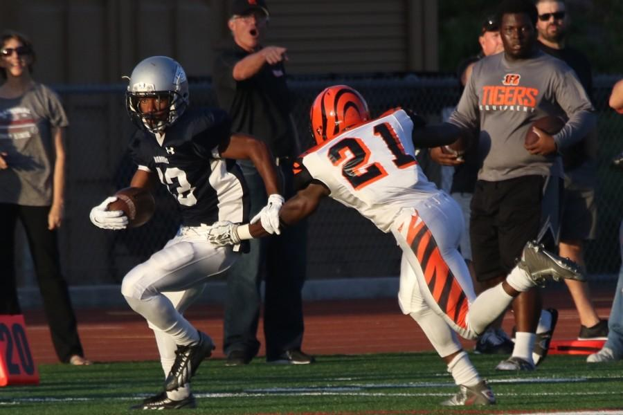 Freshman+wide+receiver+Dajuan+Parham+makes+a+run+up+the+field+to+gain+some+yards+against+Riverside+City+College+Saturday+Oct.+3+game+at+Redondo+Union.+The+Warriors+fell+to+Riverside%2C+42-21.+Photo+credit%3A+Jackie+Romano