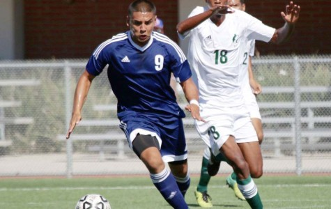 Manuel Paez (No. 9), has full control of the ball as he dribbles down-field during the game against East Los Angeles on Friday Oct. 9 at El Camino College. Photo credit: Jackie Romano