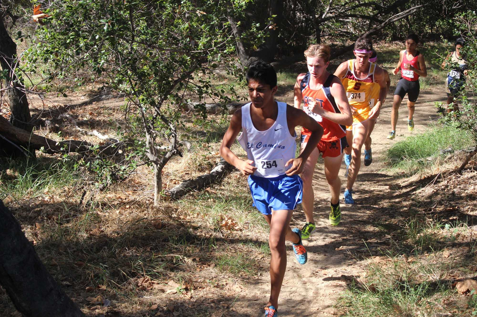 Freshman Solomon Kanehailua leads the middle of the pack for El Camino at the Brubaker Invitational on Friday, placing 28th overall behind freshman teammate, David Hodges, who placed 22nd overall. Photo credit: Roy Garza
