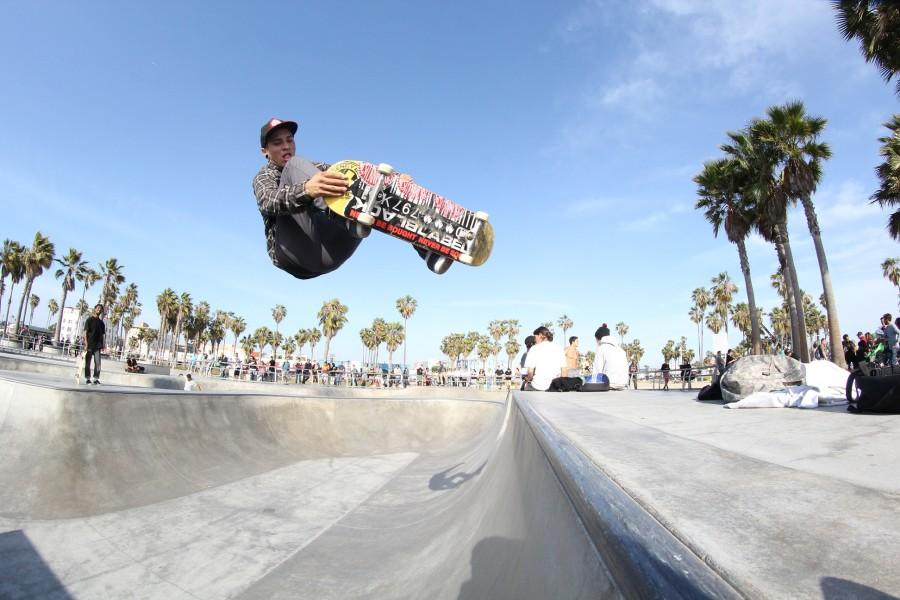 Timothy Misagal, 23, art major, floats while performing a frontside nose grab at Venice Beach. Misagal is a student at El Camino sponsored by ET Surf Shop and Westernworld Clothing. Photo credit: Jo Rankin