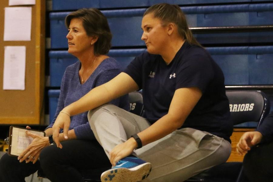 Women's volleyball head coach Le Valley Pattison (left) puts up a
