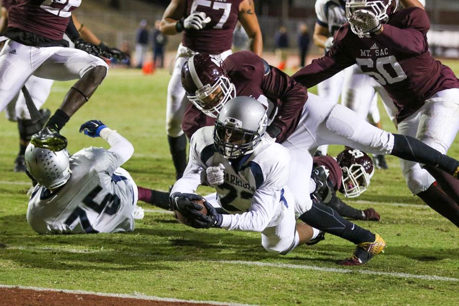 Warriors running back Tre Searcy dives onto the endzone during the third quarter. The Warriors lost 26-13 against Mt. SAC on Saturday night. Photo credit: Jorge Villa