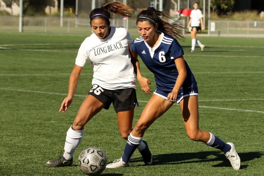 Freshman midfielder Miranda Ramirez trying to take control of the ball during the game against Long Beach City College Friday, Oct. 30 at El Camino. The Warriors defeated the Vikings, 5-2. Photo credit: Jackie Romano