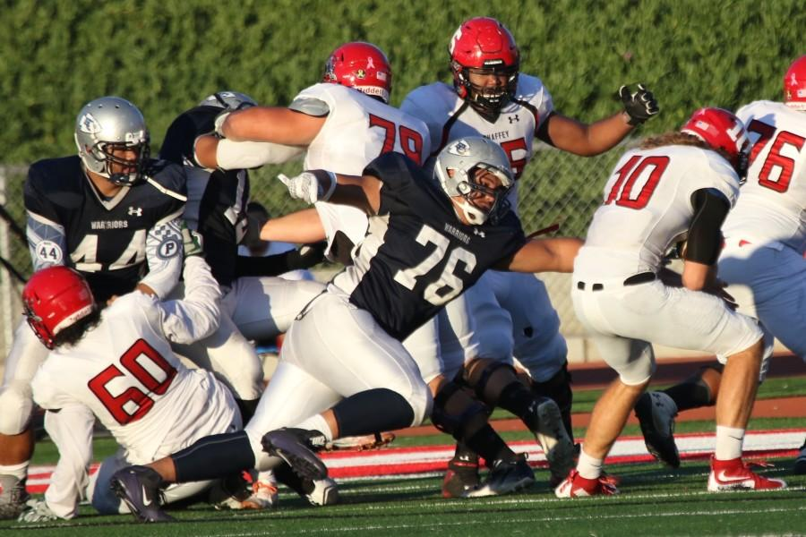 Raymond Lima, freshman defensive lineman, comes in for the tackle against Chaffey College quarterback Levi Plante, during Saturdays game at Redondo Union. The Warriors lost 34-12 against Chaffey. Photo credit: Jackie Romano