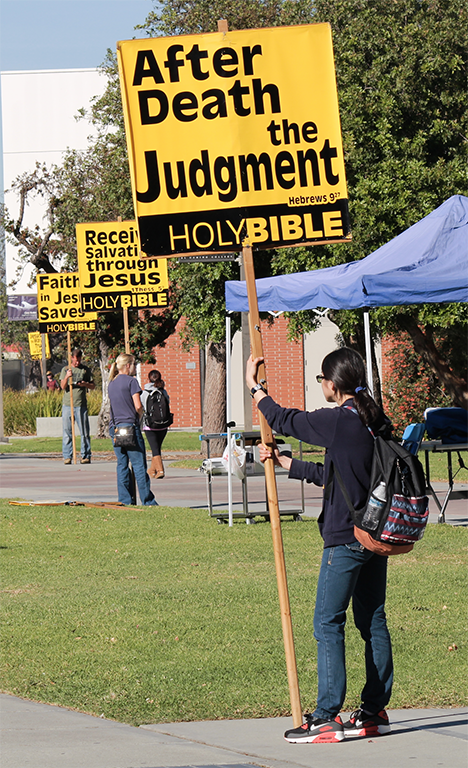 Members+of+the+Cerritos+Christian+Fellowship+stood+around+campus+with+signs+bearing+bible+verses+on+Nov.+17.+Photo+credit%3A+Roy+Garza