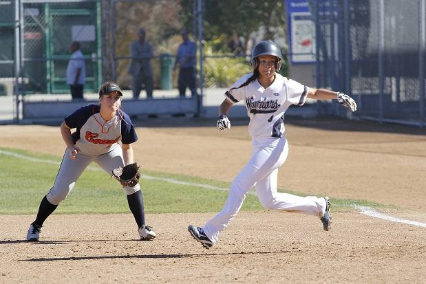 Kattya Calderon (right) looks to steal second after getting to first base against Orange Coast College in the first game of El Camino's double header on Feb. 9. The Warriors smashed the Pirates 10-1 in five innings. Photo credit: Sue Hong