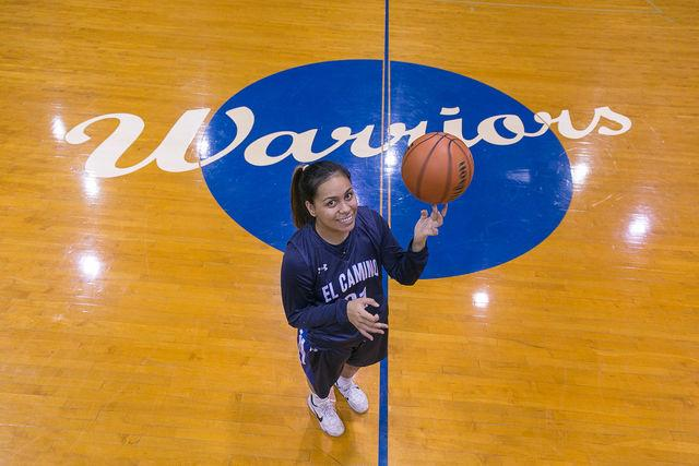 Freshman forward Meghan Peneueta poses with the ball on her finger in the middle of the North Gym. Peneueta was named 2015-16 South Coast Conference-South Co-Player of the Year. Photo credit: Elena Perez