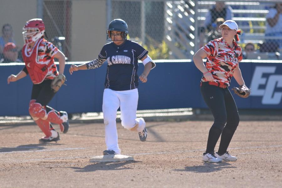 Freshman third baseman Maleigha Quintero runs to first base and makes it safe after College of the Desert fails to get Quintero out during the third inning. The warriors defeated College of the Desert 5-0 on Friday. Photo credit: John Fordiani