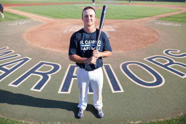 Zack Ferreira poses behind home plate. He is El Camino baseball's third baseman and has been on fire this season, helping the team to an 9-4 record. Photo credit: Jorge Villa