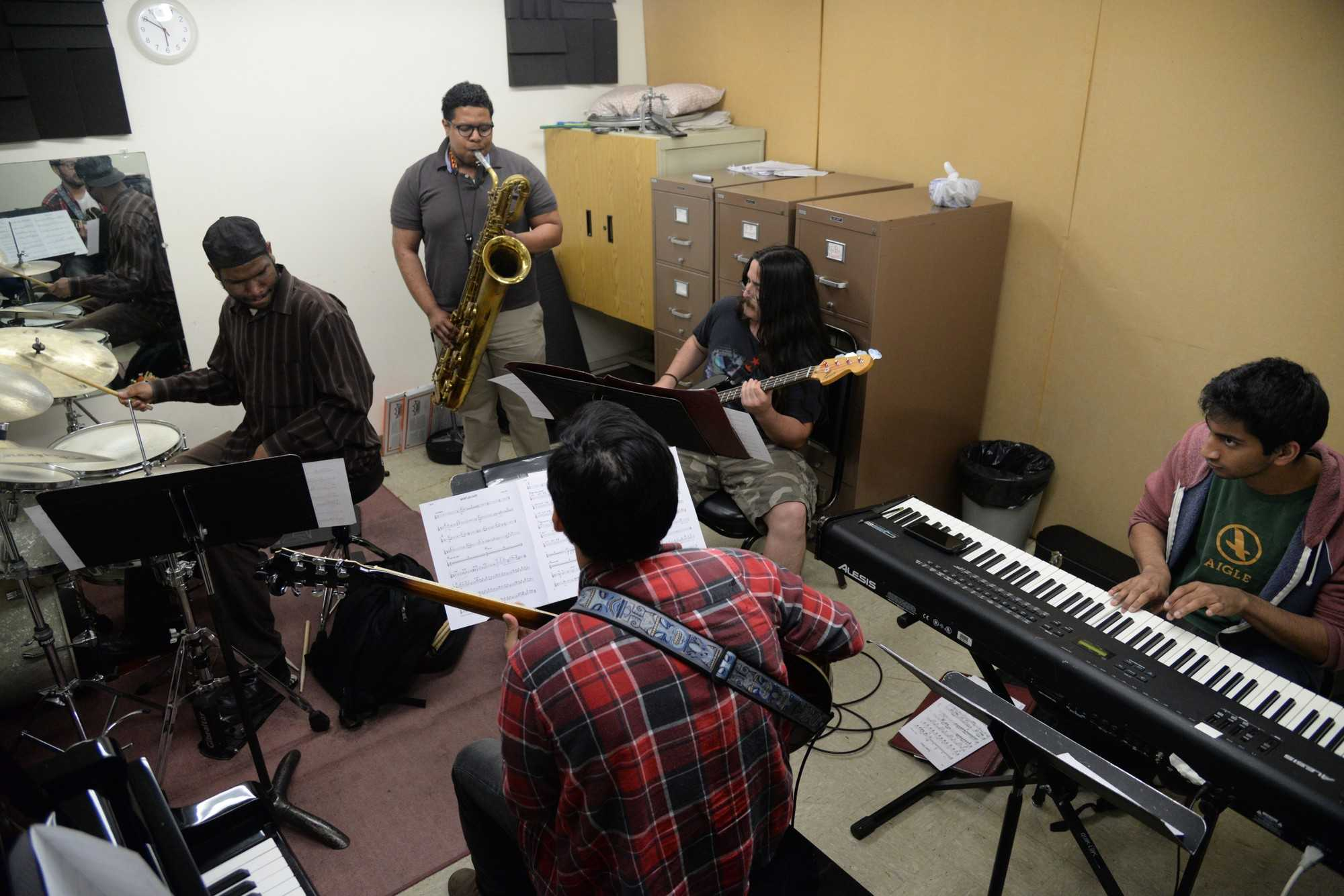 Walter Jones, 26, plays the drums, Tyler Johnson, 22, plays the saxophone, Gavin Vellems, 22, plays the bass, Srimal Del Mel, 19, plays the piano and John Aparicio, 24, plays the guitar. The band met here through the music program which they consider,