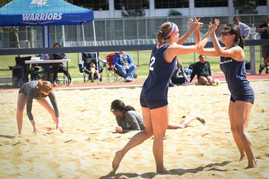 Jessica+Dow+%28left%29+and+Victoria+Curtice+celebrate+a+kill+during+the+beach+volleyball+game+against+Cypress+College+on+Wednesday%2C+March+30.+The+Warriors+defeated+the+Chargers+in+a+5-0+sweep+to+remain+undefeated.+Photo+credit%3A+Sue+Hong