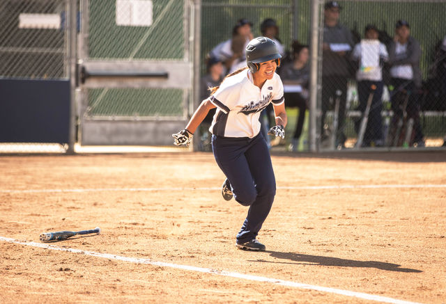 Freshman outfielder Kattya Calderon, dashes towards first base during a home game against MT. San Antonio College Tuesday March 29th. The Warriors defeated the Mounties, 9-7. Photo credit: Gabriela Better