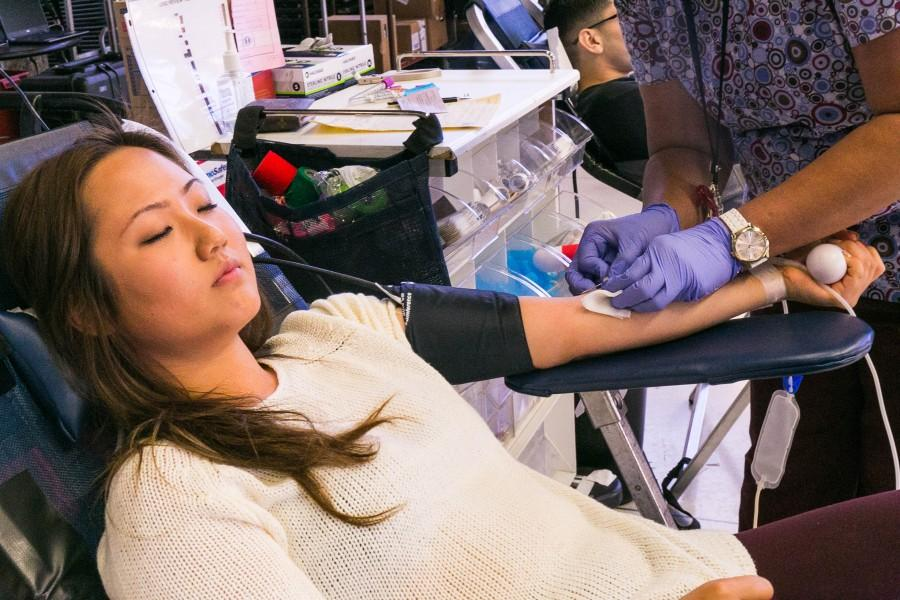 Hanna Chu, 19, neuroscience, tries to relax before getting blood drawn from her in the Students Activity Center on Tuesday. The Inter Club Council (ICC), Iota Kappa Chi, and Cedars-Siani Medical Center is hosting the event until Thursday. Photo credit: Elena Perez