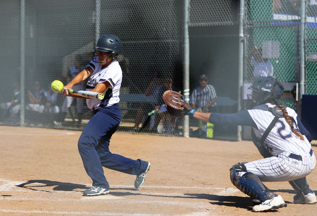 Freshman outfielder Aleah Lacy looks to connect with a pitch during a game against Cypress College Saturday, April 23. Photo credit: Jo Rankin