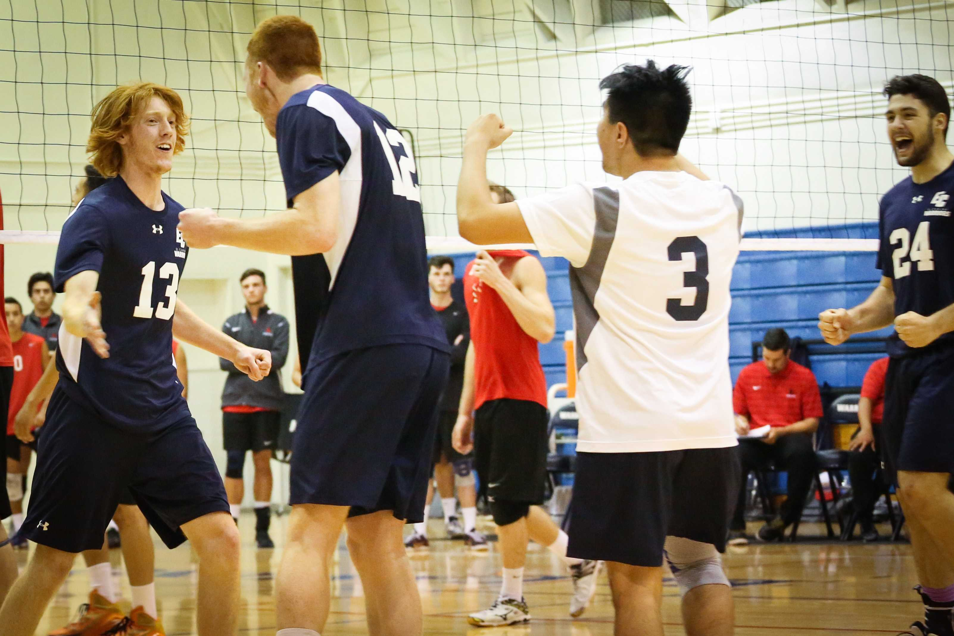 Outside hitter Josh Riblett (from left), middle blocker Peter Nordel, libero Andre Labayen, and setter Michael Otazu celebrate as they tie the game at 8-8 during set four. The Warriors played a home game against the Vikings on April 6. Photo credit: Sue Hong