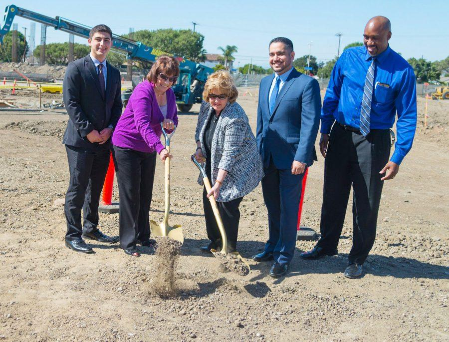 El Camino president Dena Maloney and members of the board of trustees take a hand at the ground breaking for the new Lot C parking structure, marking the beginning of the new construction on Monday, April 18. The new parking structure is scheduled to be completed in about a year. Photo credit: Elena Perez