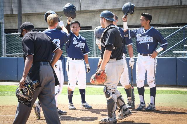 from left: Nick Sablock (Sophomore) outfielder, Kyle Henmi (Freshman) infielder, and Noah Barba (Freshman) outfielder each score at the bottom of the 4th. They lead the EL Camino-Compton Center, 6-1, and raise their helmets in celebration. Photo credit: Sue Hong
