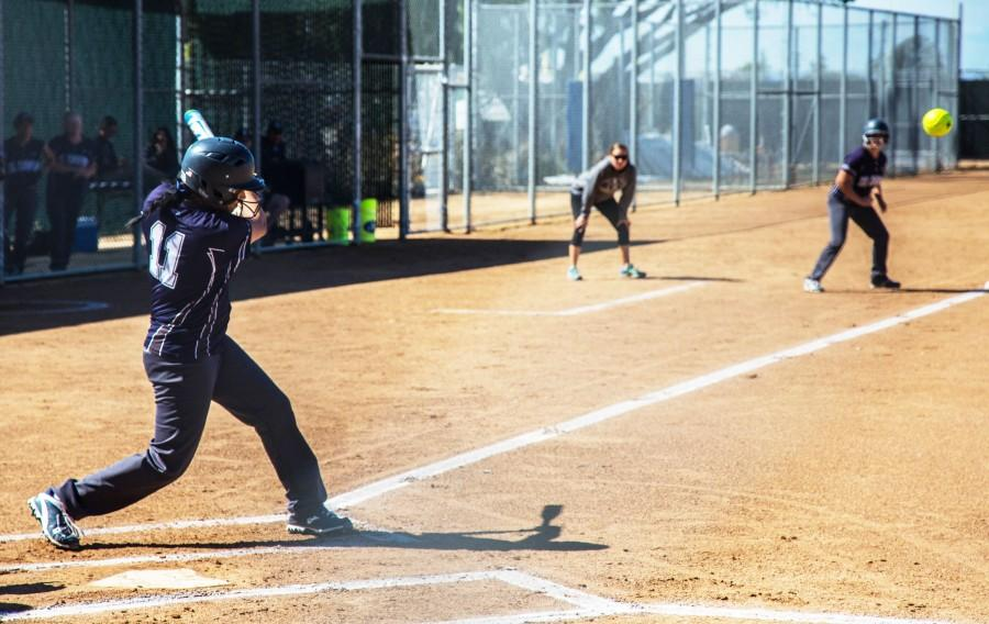 Warrior's freshman third base player Maleigha Quintero swings her bat and hits the pitch on the Thursday March 31st game against ECC-Compton Center. Photo credit: Gabriela Better