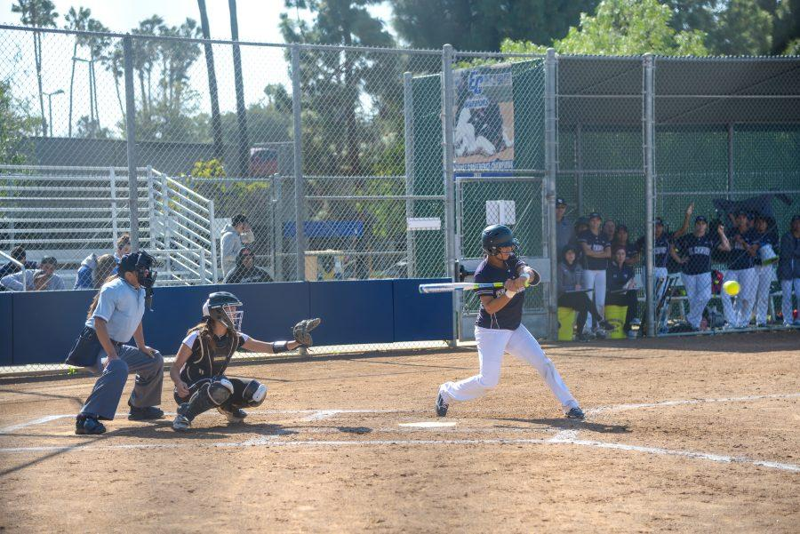 El Camino softball player swings at a pitch during a home game on Monday, April 25. Photo credit: Elena Perez