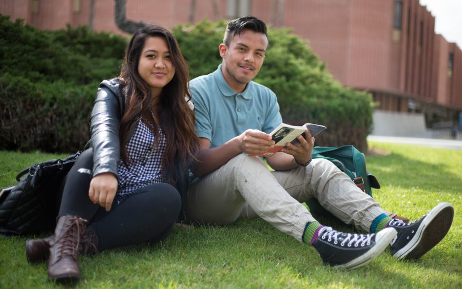 Kimberly Nguyen, 22, business major and John Escareno 21, English major, both are members of  Empower the Community group known as ETC a non-profit organization where together they coordinate projects that supports the group's mission to  empower the youth. Photo credit: Gabriela Better