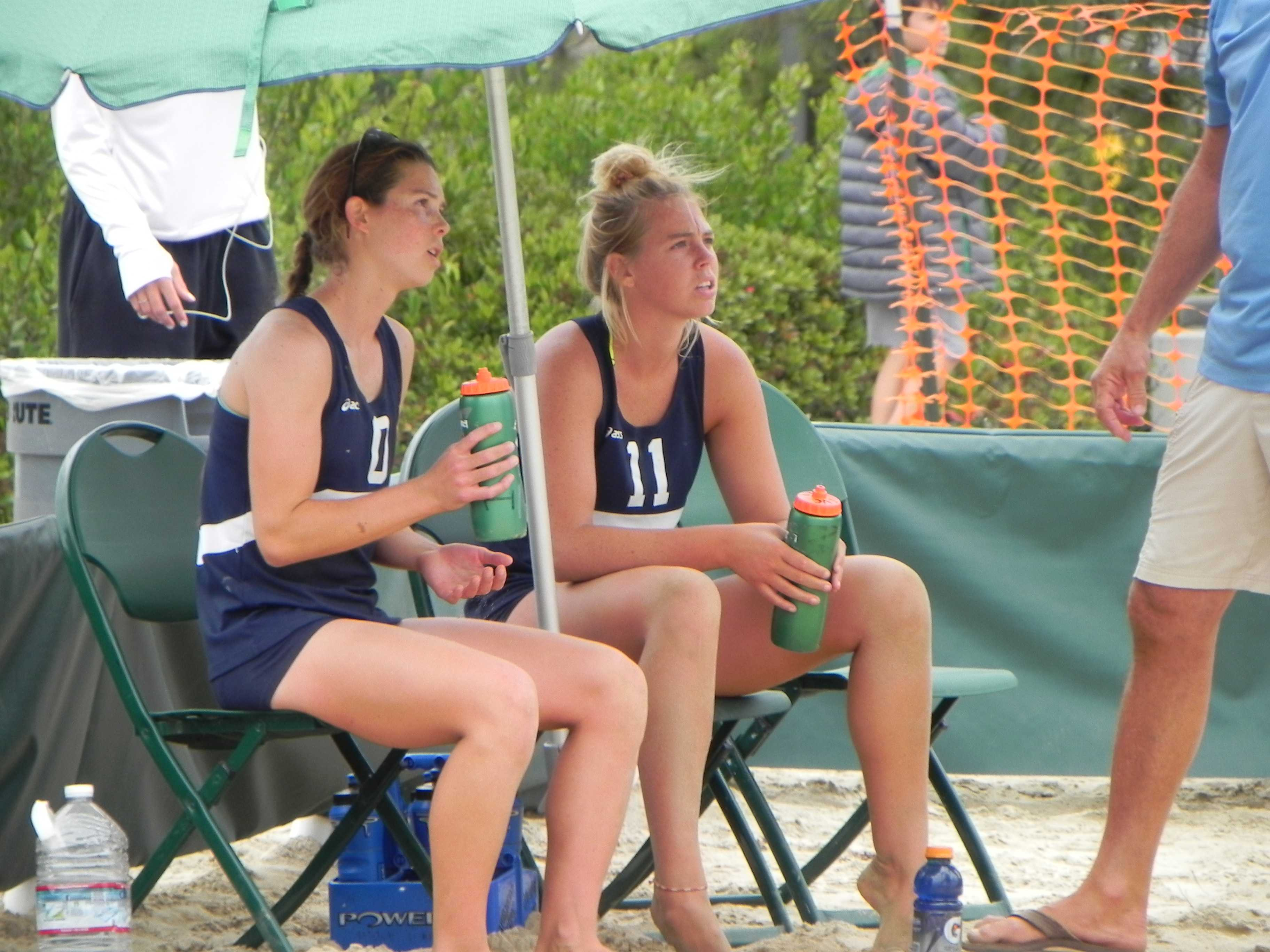 Emily Reinking (left) and Hailee Earnest, of Irvine Valley College, sit down and listen to their coach in between set one and two of the championship match at Grossmont on Sunday. Reinking and Earnest were the No. 3 overall seed and beat the No. 4 seed of Cady Francis and Brianna Sizemore in two sets in the finals, 21-15, 21-18. Photo credit: Phil Sidavong