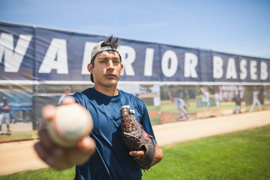 Sebastian Sanchez, 24, undecided freshman pitcher warms up every Tuesday that gives him the winning edge with a 9-2 record. Photo credit: Jorge Villa