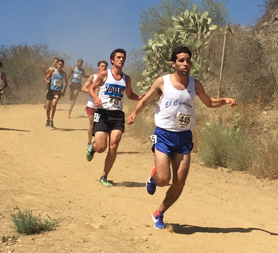 Sophomore+Israel+Cardona+%28No.+445%29+takes+on+a+steep+downhill+slope+at+the+Brubaker+Invitational+on+Friday%2C+Sept.+16%2C+2016.+Photo+credit%3A+Roy+Garza