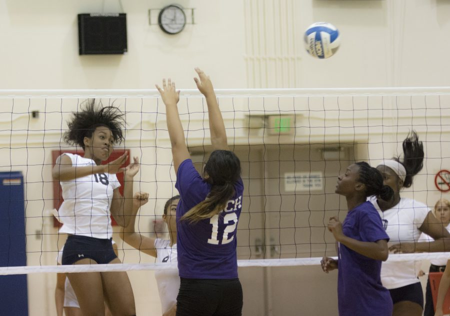 Glorious Owens, freshman middle blocker, attacks the ball over the L.A. Trade Tech block. The El Camino women's volleyball team routed the Beavers in a straight-set sweep on Wednesday night. Photo credit: Elijah Hicks