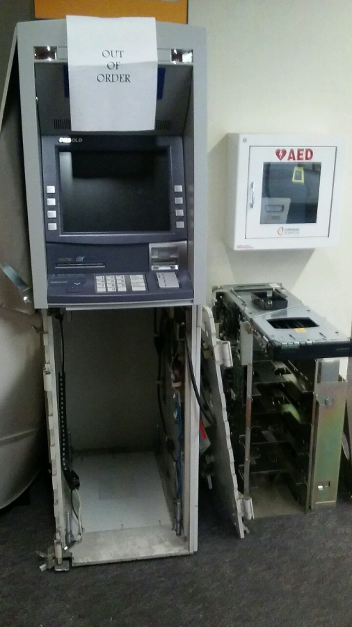 An unknown number of suspects broke into Schauerman Library and accessed the ATM machine and stole an unknown amount of money some time between Sunday night and Monday morning. The entire ATM was destroyed on the left side. Photo credit: Shontel Leake