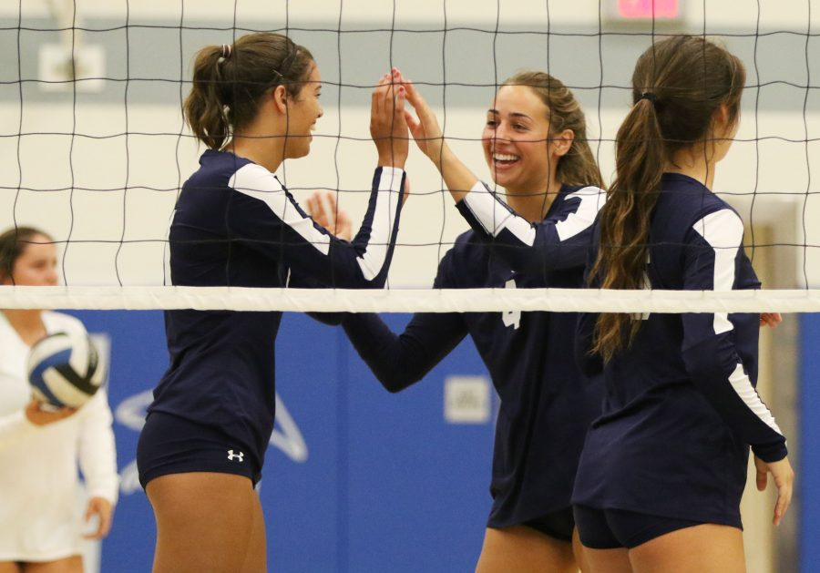 El Camino's freshman outside hitter Jaylin Motley, and sophomore opposite hitter Taylor Brydon celebrate a point against Cerritos College on Sept. 23. Photo credit: Jo Rankin