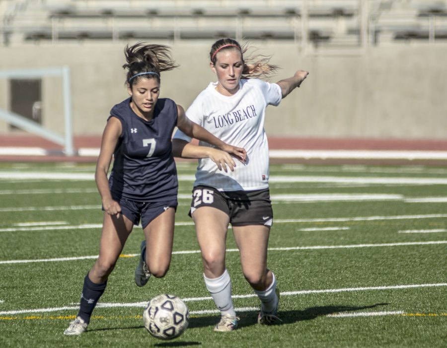 El Camino defender Miranda Ramirez (No.7) steals the ball from Long Beach City College defender Aubree Furman Tuesday, Nov. 1, at Murdock Stadium. Photo credit: Elijah Hicks