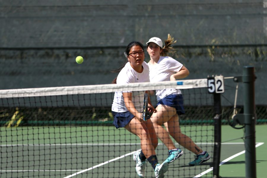 Sophmore+Natsuki+Hoshiko%2C+swings+the+returning+play+with+a+backhand+from+the+Cerritos+College+women%27s+tennis+team%2C+as+freshman+Stephanie+Kingham+runs+back+into+position.+The+warriors+fell+short+in+each+doubles+play+and+as+a+result+lost+2-8+at+El+Camino+on+Tuesday%2C+March+28.+Photo+credit%3A+Jorge+Villa