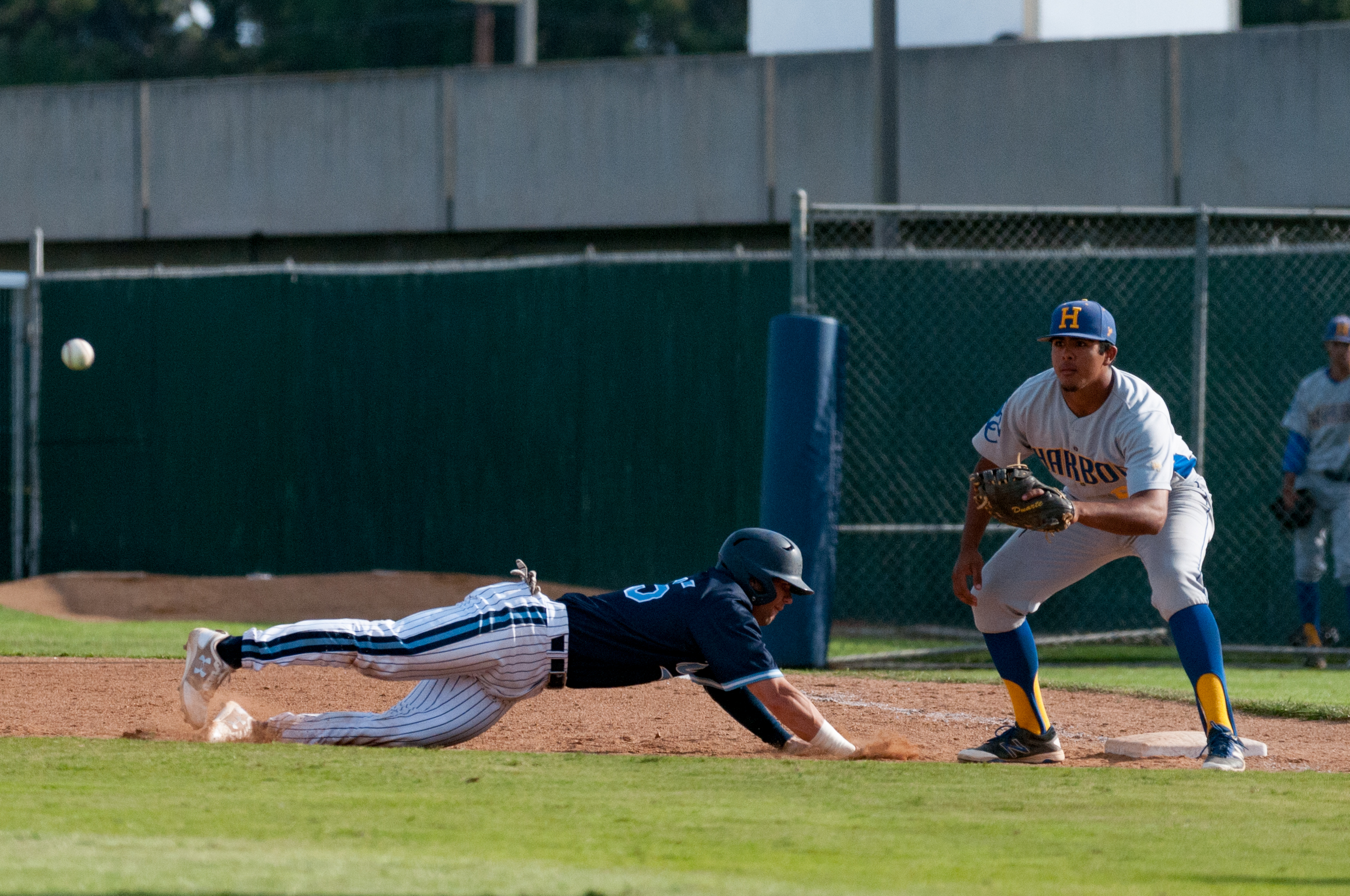 Sophomore catcher Trevor Casanova slides back into first base during El Camino's game against L.A. Harbor College on Tuesday, April 4 at Warrior Field. Photo credit: Osvaldo Deras