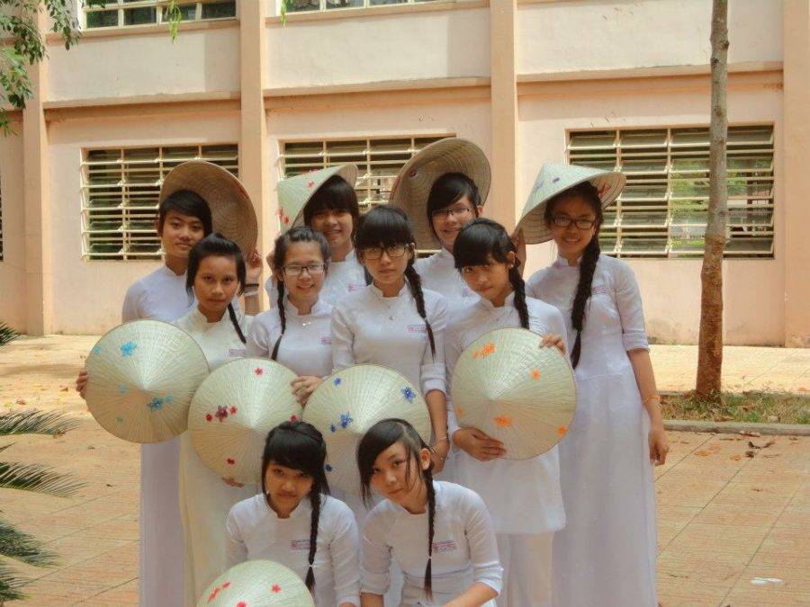 Duyen Le with her friends wearing their traditional coustume,