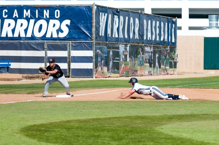 Freshman outfielder Ty Conrad (No. 21) slides in to third base against El Camino-Compton Center on Thursday, March 30 at Warrior Field. Photo credit: Osvaldo Deras