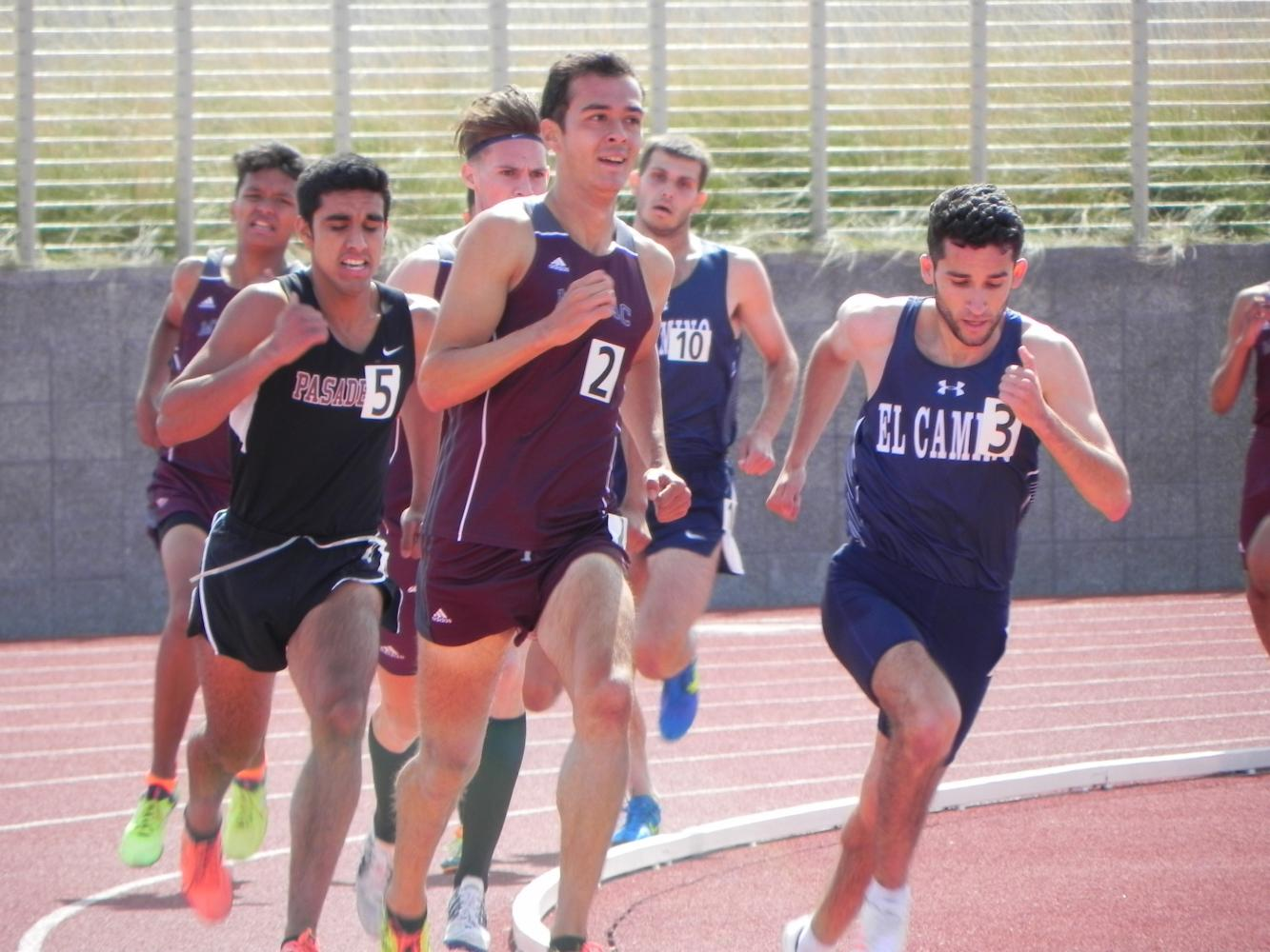 El Camino's Israel Cardona (right) begins to make his move to the front of the pack in the men's 1500 meter race at Murdock Stadium on Friday, April 28. Cardona won the event with a time of 4:05.21. Photo credit: Don Perez