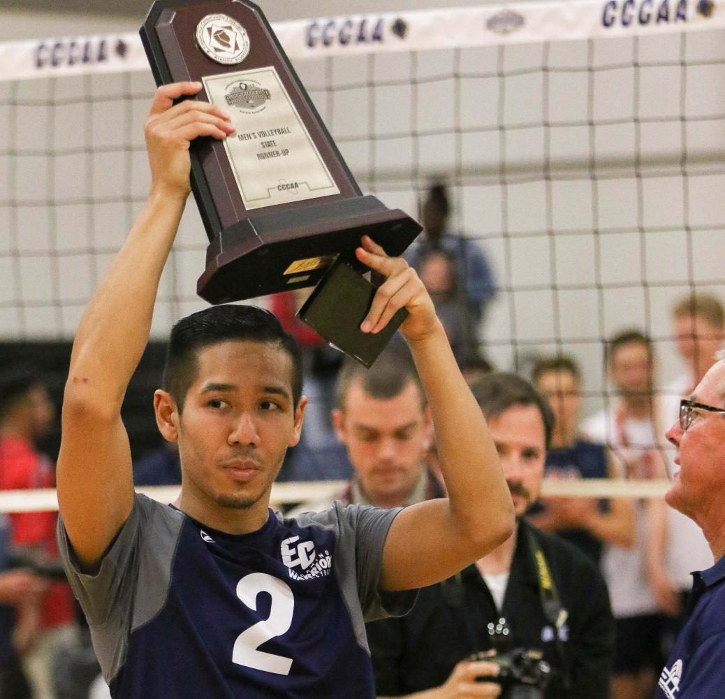 Sophomore outside hitter and co-captain Chris Phanngam holds up the second-place trophy after the El Camino men's volleyball team lost to Orange Coast College in the State Finals. Photo credit: Jorge Villa
