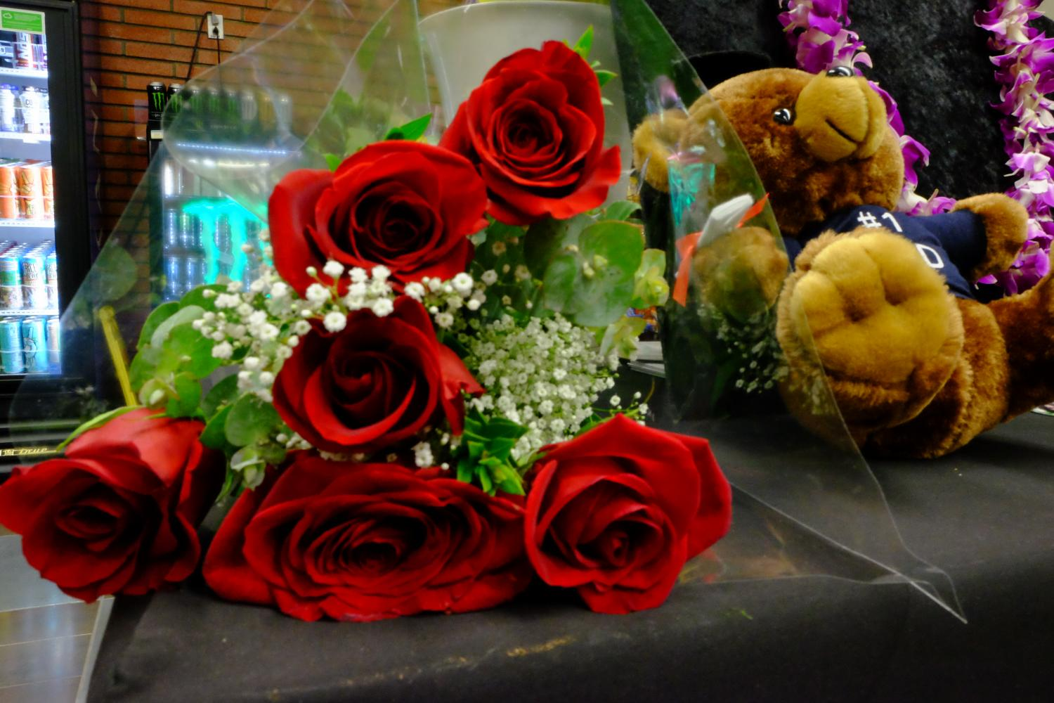 A bouquet of roses and baby's breath sits at the Commencement Flowers booth at Grad Fest. Photo credit: Emma Dimaggio