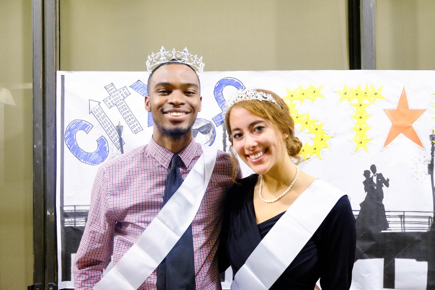 Representative of Society of Music, Kayla Atkinson and Black Student Union club president and ASO Director of Academic Affairs Bryant Odega, who were respectively crowned king and queen of homecoming. Photo credit: Emma Dimaggio