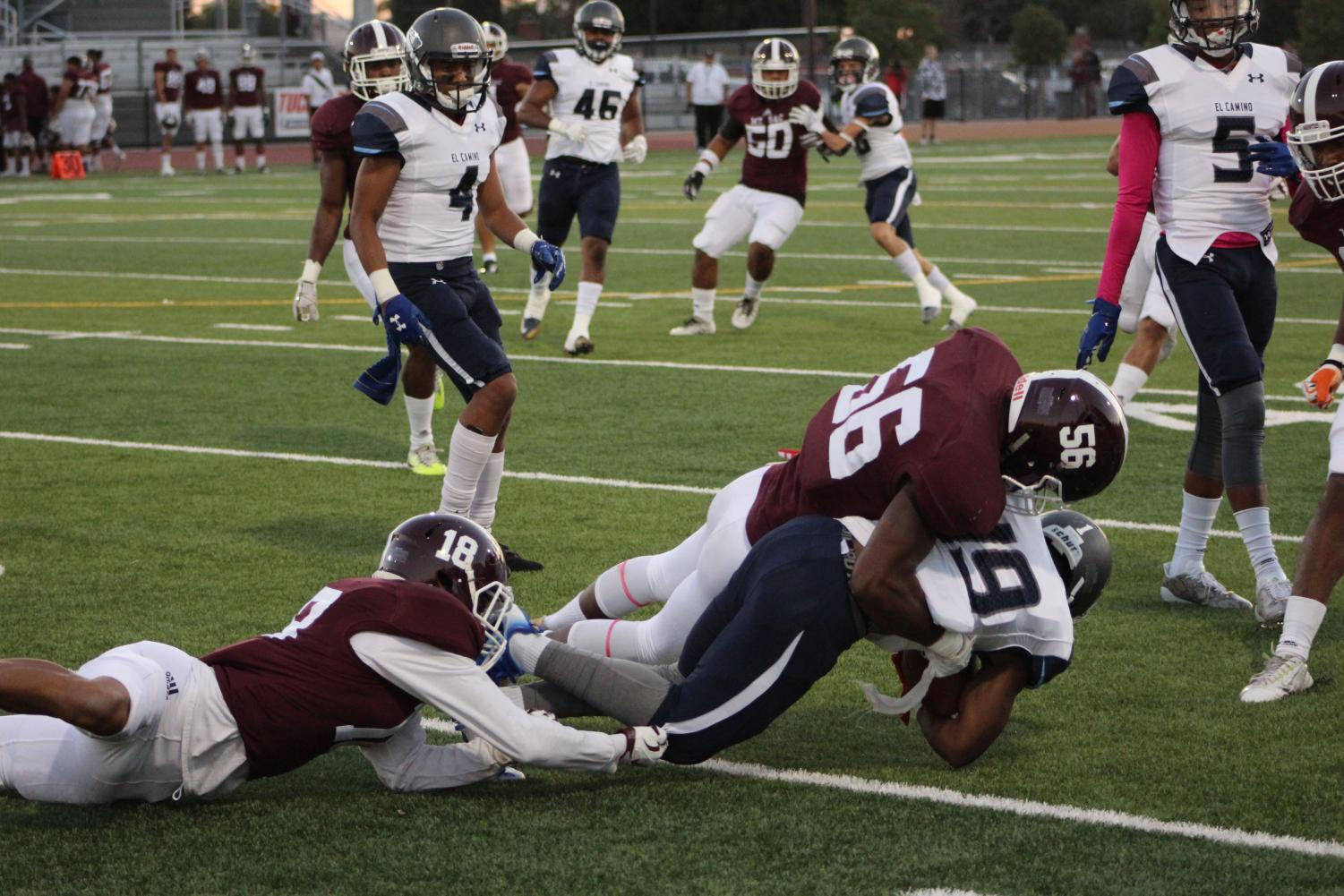 EC running back Kishawn Berry (No. 19) is tackled by Mt. SAC linebacker Jordan Otey-Wilson (No. 56)  in a loss to the Mounties.