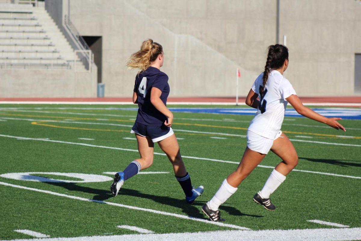 EC forward Robin Riggs running to put pressure on Cerritos defense. Photo credit: Alissa Lemus