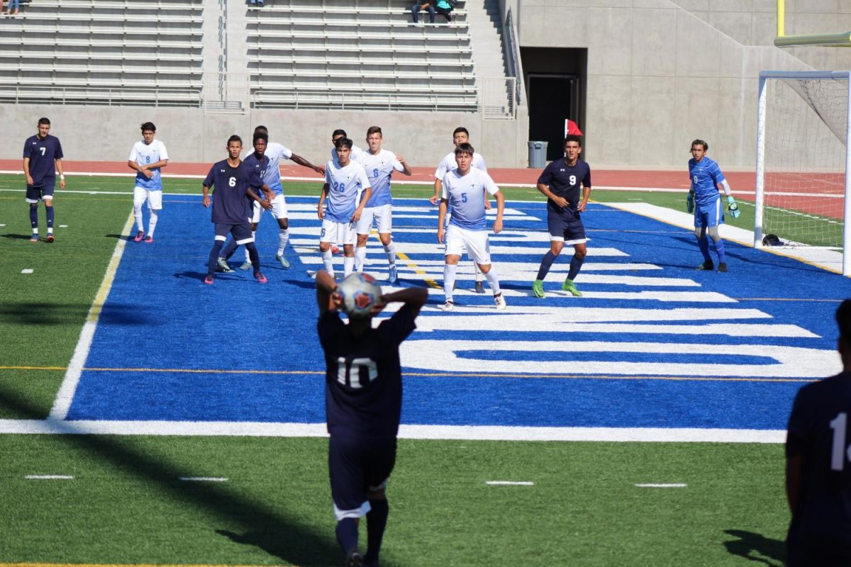 EC mid-fielder Reyes Jaimes throwing in the ball near the 18 yard box. EC players are eager to get the ball in the net. Photo credit: Alissa Lemus
