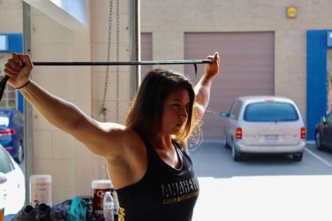 Ali Ludwig warming up her shoulders before her training session. Photo credit: Jeremy Taylor