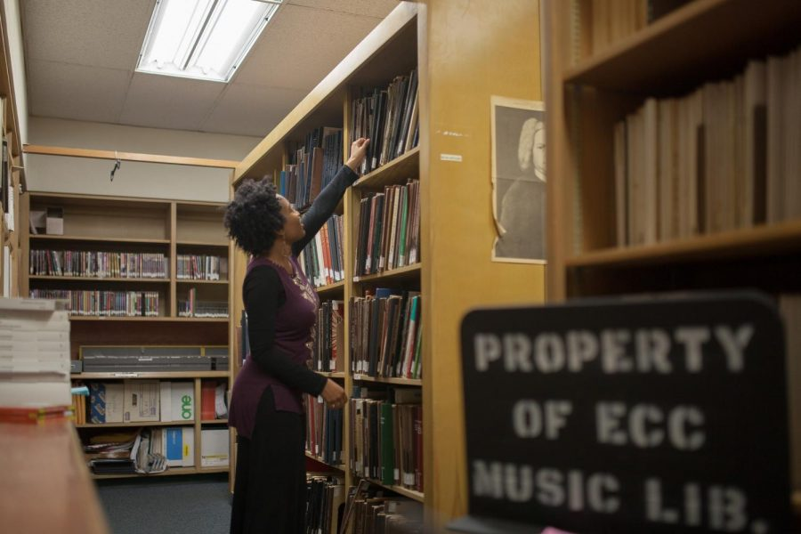Adriann+Smith%2C+25+a+student+worker+who+works+as+a+librarian%2C+reaching+for+musical+notes+in+the+back+storage+catalog+of+the+Music+Library.+Smith+is+a+pianist+and+often+finds+herself+looking+at+her+favorite+musical+composers+work%2C+Sergei+Prokofiev%2C+who+is+also+a+pianist+and+conductor+as+inspiration.+Photo+credit%3A+Jorge+Villa