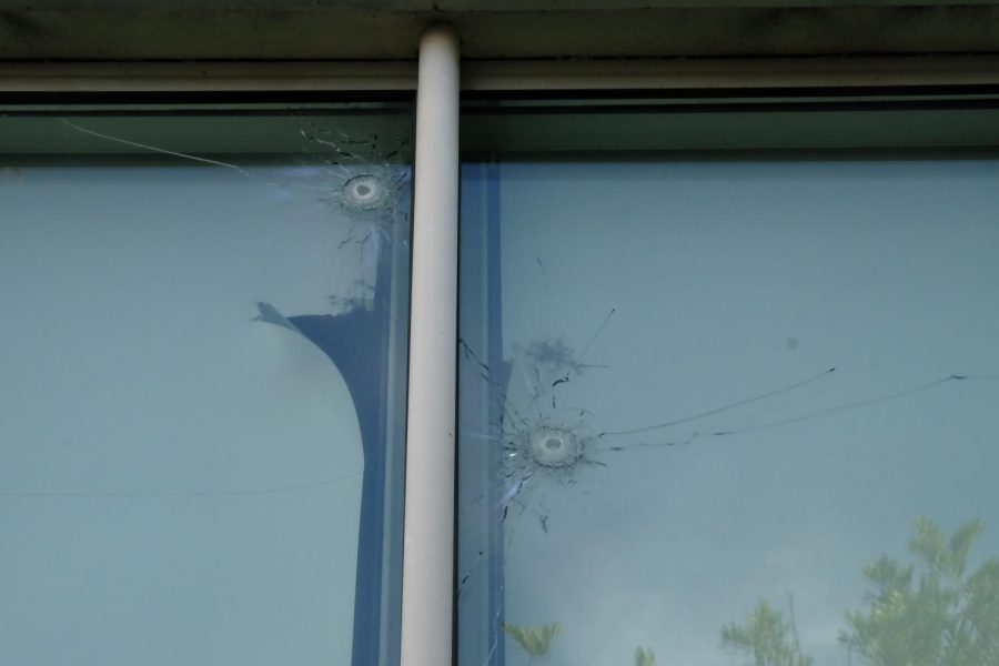 The two bullet holes on the upper edges of a window pane in Life Sciences Room 105. The bullets partially shattered the window and ripped apart the fabrics used to block sunlight in the classroom. Photo credit: Emma Dimaggio