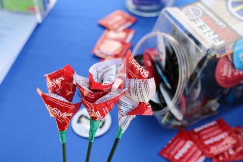 Student Health Services give out condom roses on National Condom Day